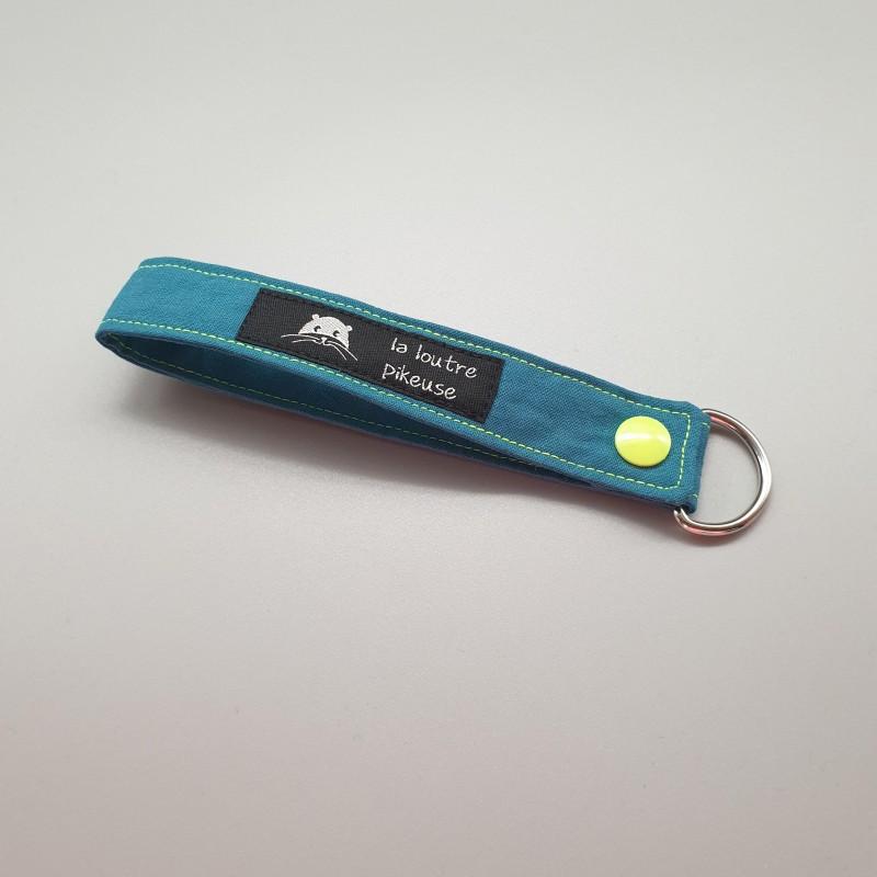 Porte-clé capsule fluo - vert canard