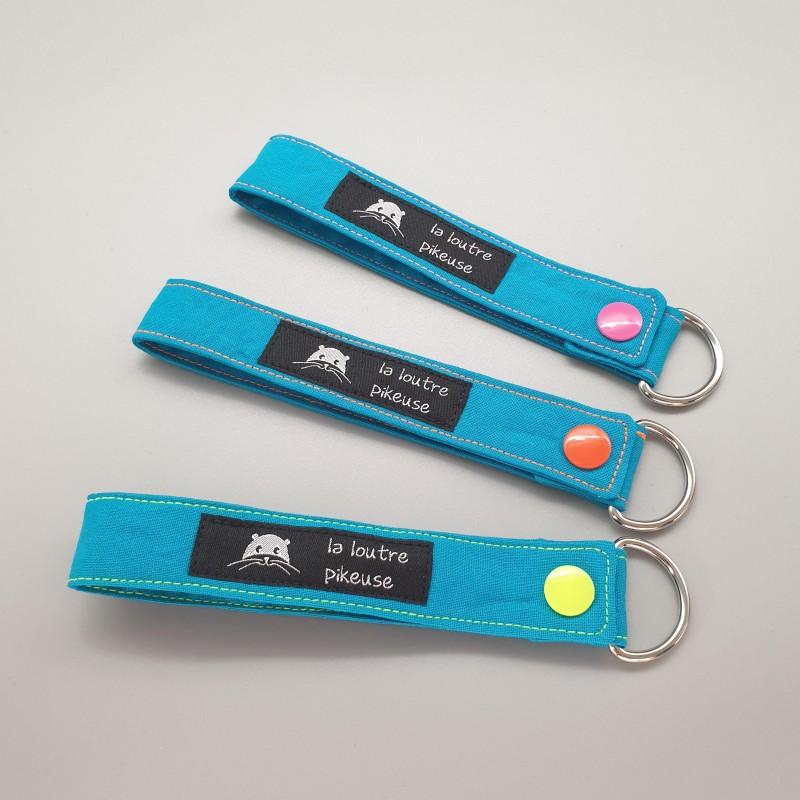 Porte-clé capsule fluo - bleu turquoise