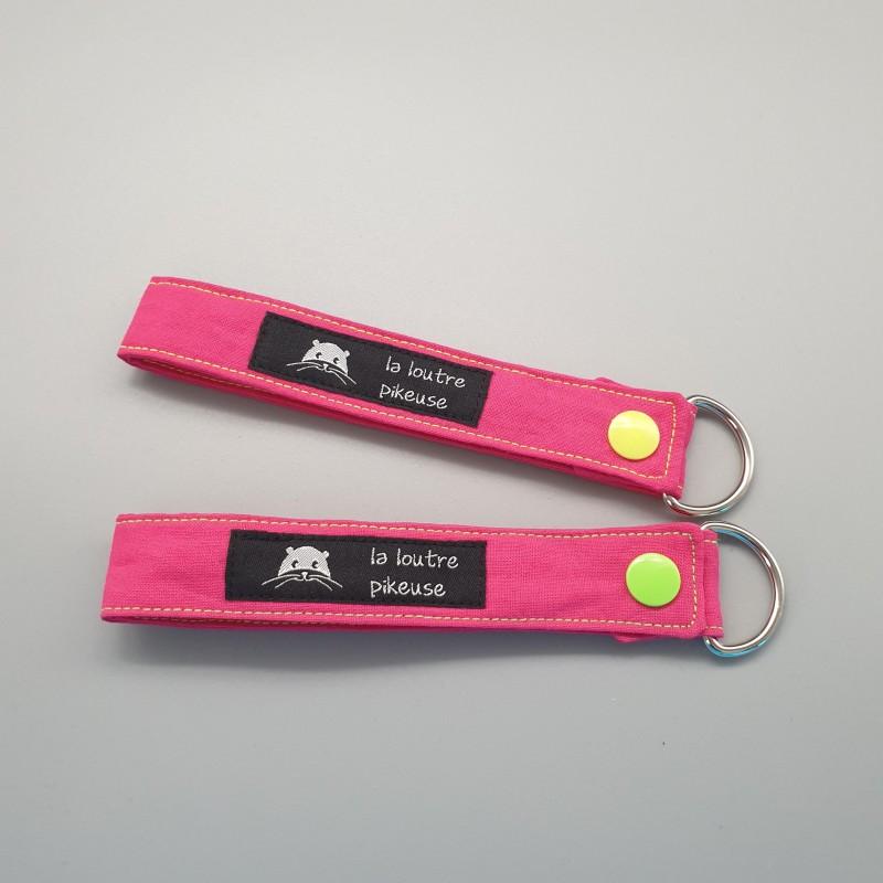 Porte-clé capsule fluo - rose