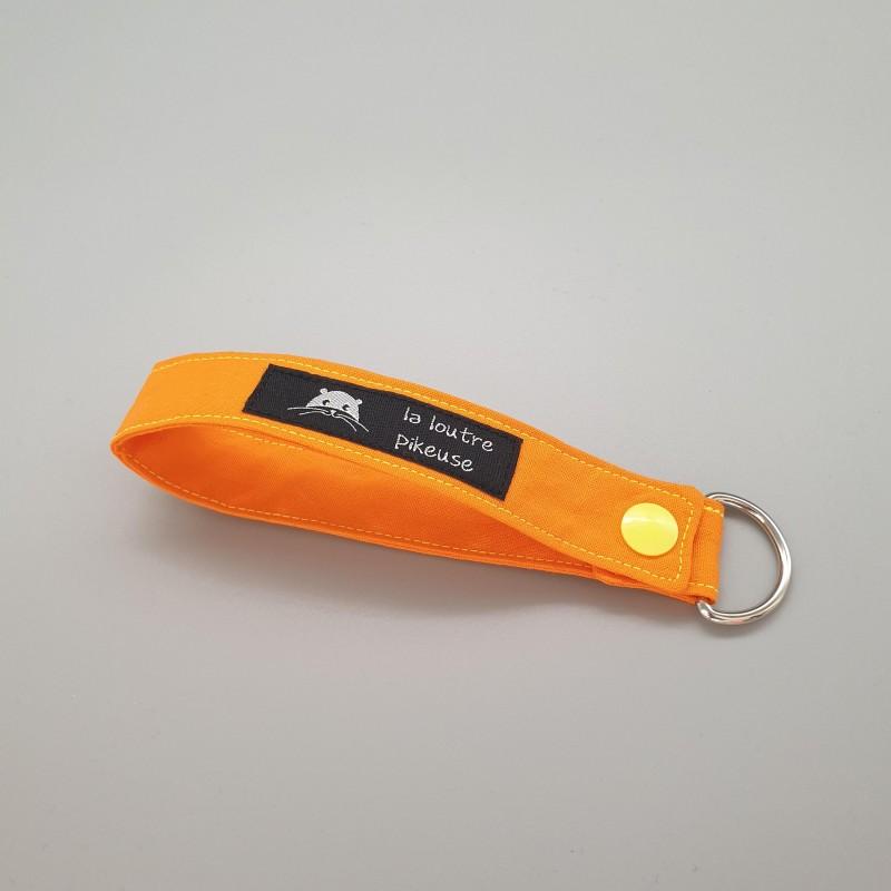 Porte-clé capsule fluo - orange