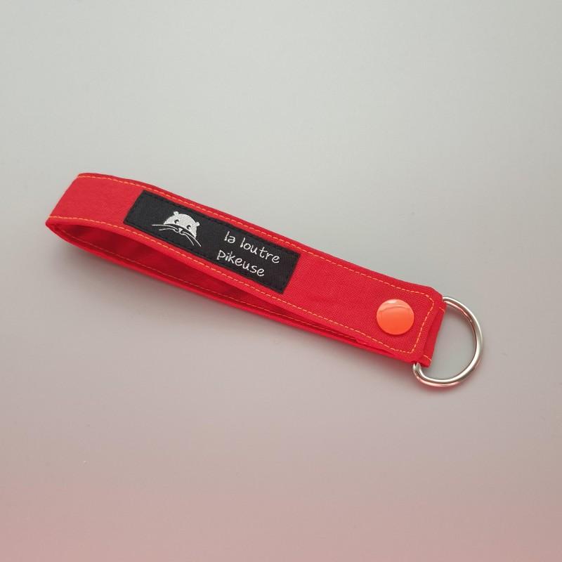 Porte-clé capsule fluo - rouge